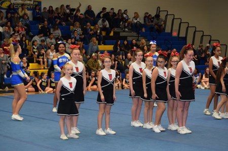 cheer team in gymnasium
